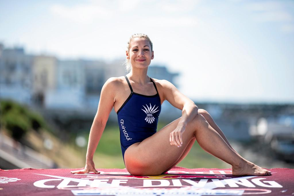 Lysanne Richard of Canada poses for a portrait on the 21 metre platform prior to the third stop of the Red Bull Cliff Diving World Series in Polignano a Mare, Italy on May 30, 2019. // Dean Treml/Red Bull Content Pool // AP-1ZHZABU9N2111 // Usage for editorial use only //