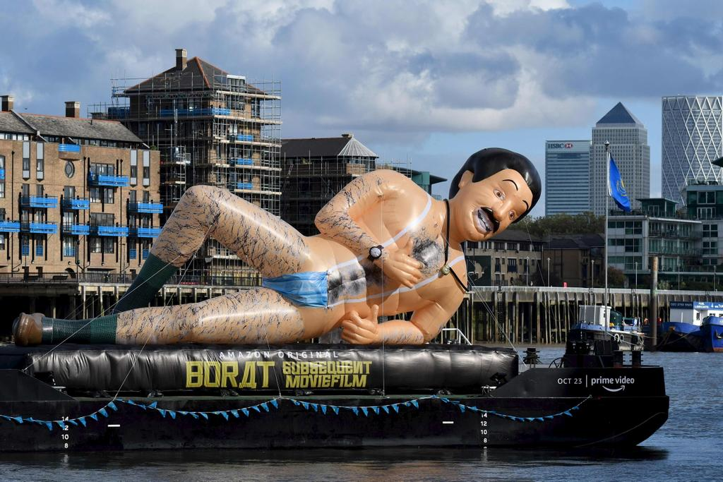 An inflatable in the form of Borat, UK comedian Sacha Baron Cohen's fictional Kazakh reporter floats down the River Thames in London to promote the release of the sequel, Borat Subsequent Moviefilm on October 22, 2020.