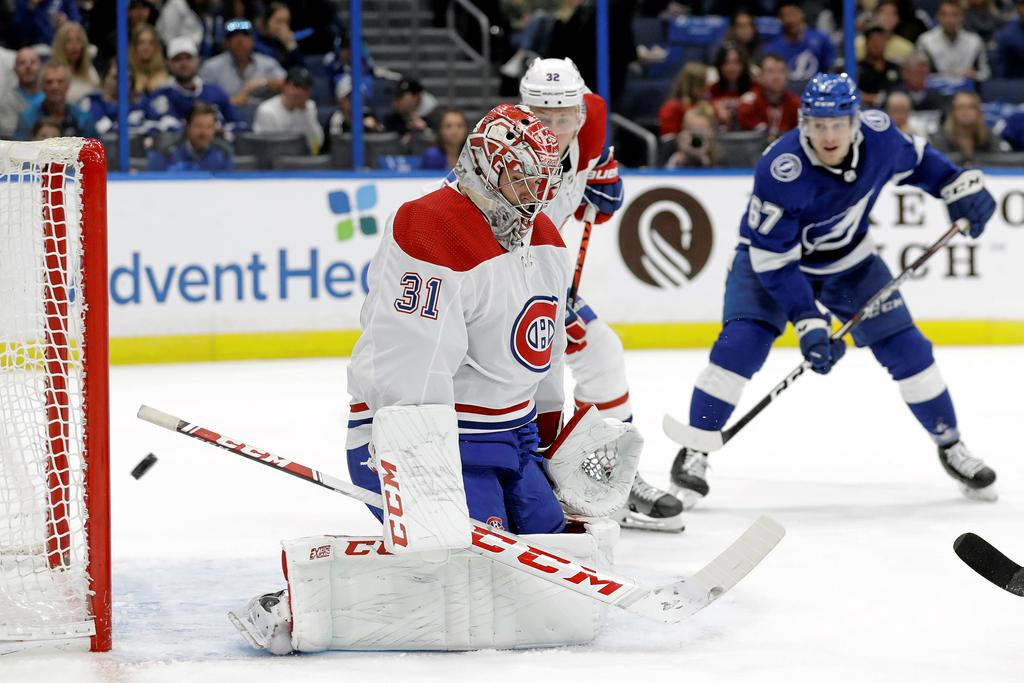 Montreal Canadiens goaltender Carey Price (31) makes a pad save on a shot by the Tampa Bay Lightning during the second period of an NHL hockey game Thursday, March 5, 2020, in Tampa, Fla. (AP Photo/Chris O'Meara)