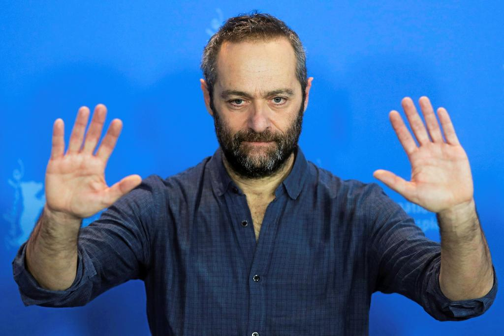 Director Cedric Kahn poses at a photo-call for the film 'The Prayer' during the 68th edition of the International Film Festival Berlin, Berlinale, in Berlin, Germany, Sunday, Feb. 18, 2018. (AP Photo/Markus Schreiber)