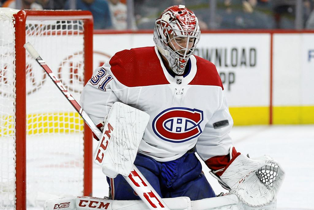 Montreal Canadiens' Carey Price blocks a shot during the second period of an NHL hockey game against the Philadelphia Flyers, Thursday, Nov. 7, 2019, in Philadelphia. (AP Photo/Matt Slocum)