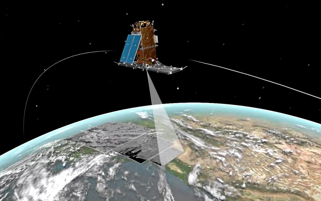 Satellite de la constellation RADARSAT (RCM) prenant des images.