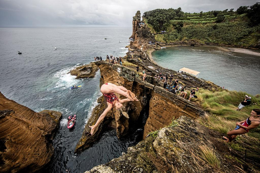 Lysanne Richard of Canada dives from a 20 metre cliff during the first round of the fifth stop of the Red Bull Cliff Diving World Series, Islet Franco do Campo, Azores, Portugal on July 17th 2015.