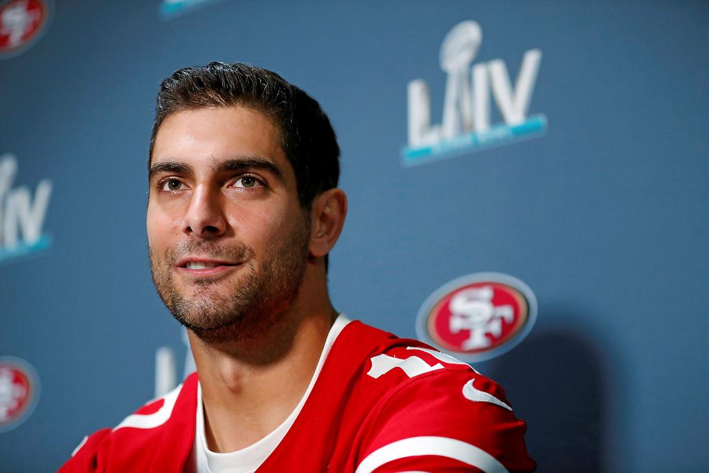 San Francisco 49ers quarterback Jimmy Garoppolo smiles as he speaks during a media availability Wednesday, Jan. 29, 2020, in Miami, for the team's NFL Super Bowl 54 football game against the Kansas City Chiefs. (AP Photo/Wilfredo Lee)