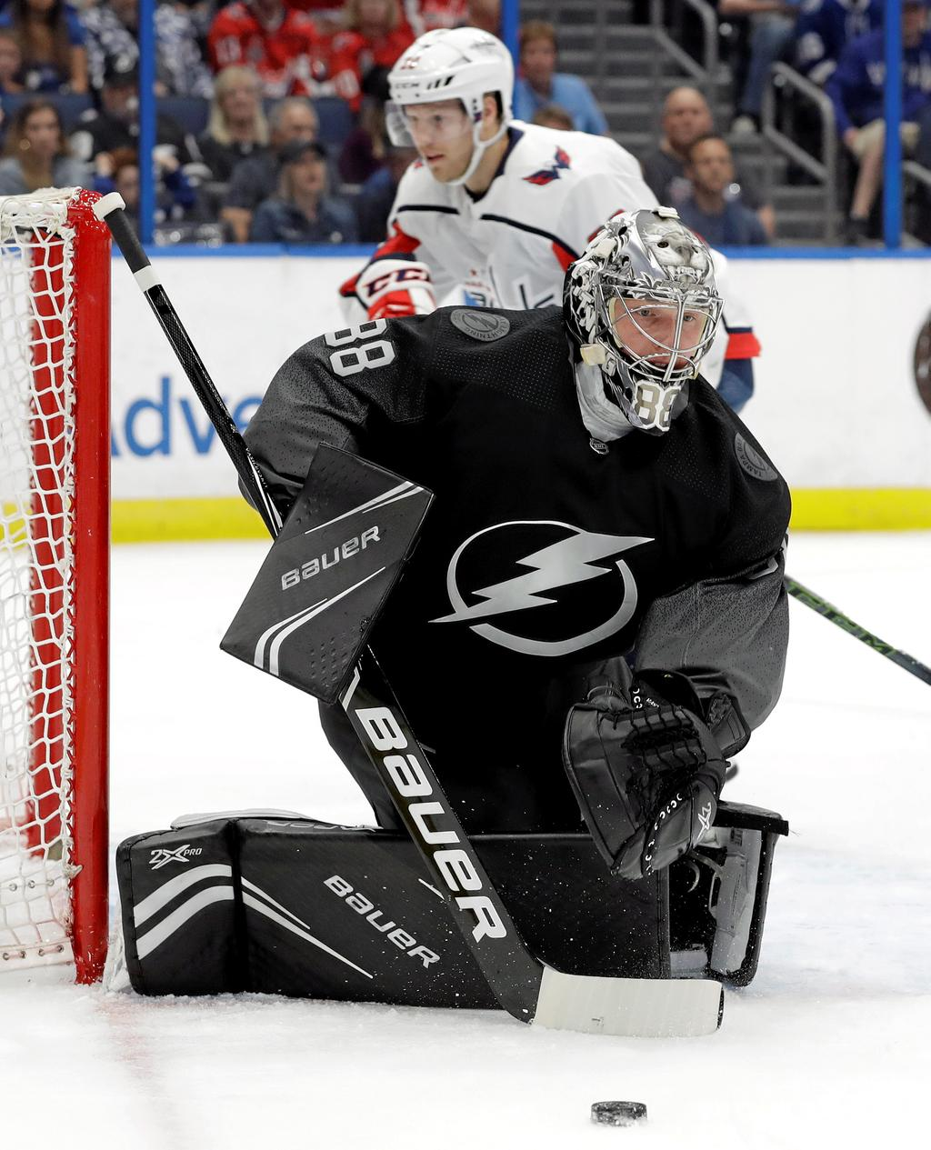 Tampa Bay Lightning goaltender Andrei Vasilevskiy (88) makes a stick save on a shot by the Washington Capitals during the first period of an NHL hockey game Saturday, March 30, 2019, in Tampa, Fla. (AP Photo/Chris O'Meara)