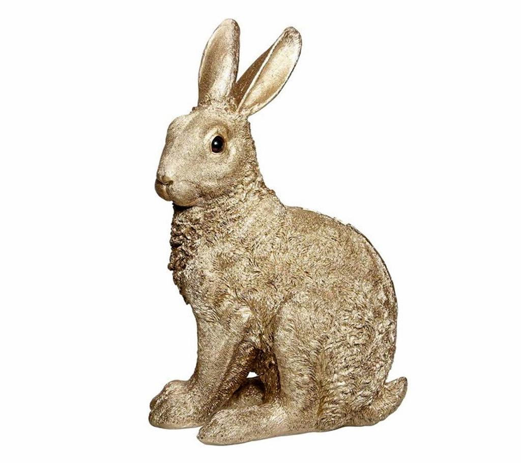 Tirelire lapin or, 68$ chez Zone